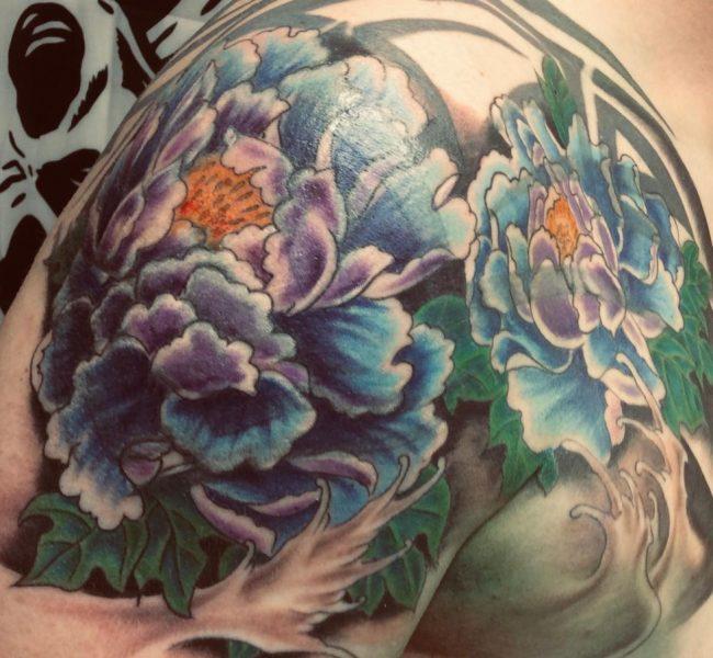 Cover UP Tattoo am Oberkörper / Arm / Schulter - Tattoo by Daniel Pavlik